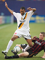 Tyrone Marshall of the Galaxy can't avoid the tackle of John Wolyniec of the MetroStars. The LA Galaxy lost to the NY/NJ MetroStars 1-0 on 6/21/03 at Giant's Stadium, NJ..