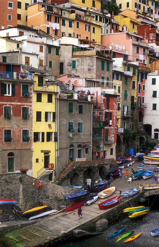 ITALY, Liguria, Riomaggiore, Cinque Terre  fishing village of Riomaggiore with multicolored houses