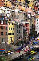 ITALY, Liguria, Riomaggiore, Cinque Terre  fishing village of Riomaggiore with multicolored houses