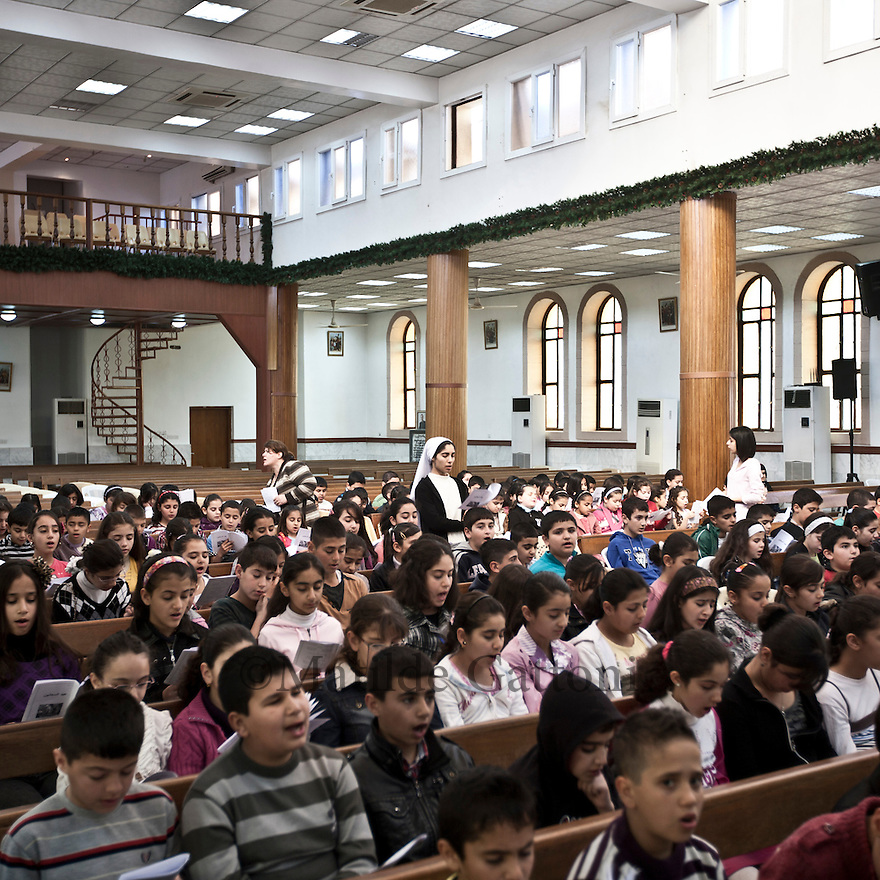 Iraq - Kurdistan - Ankawa - Children singing religious songs inside St Joseph Cathedral.
