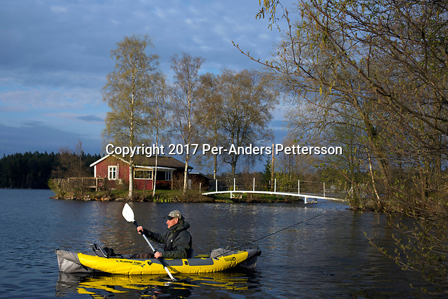 BORAS, SWEDEN - MAY 14: A man paddles his canoe while going fishing on May 14, 2017 in Dannike outside Boras, Sweden. The lake is called Ramsjon, about twenty minutes outside Boras. (Photo by Per-Anders Pettersson/Getty Images)
