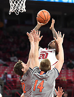 NWA Democrat-Gazette/J.T. WAMPLER Arkansas' Darious Hall shoots while Bucknell's John Meeks (12) and Ben Robertson defend Sunday Nov. 12, 2017 at Bud Walton Arena in Fayetteville. Arkansas won 101-73 and takes on Fresno State Friday at home.