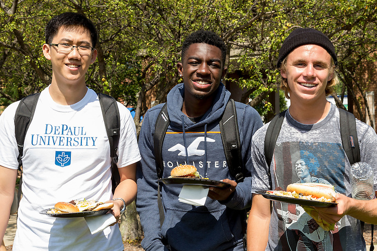 "Left to right, Yuzhou Lu, Carl Rowens and Drake Roby, incoming freshmen students, enjoy some food during the Discover Chicago Immersion Week kick-off BBQ, Monday, Aug. 29, 2016, in the Lincoln Park Campus Quad. Each year, the week before fall quarter begins, hundreds of first-year students venture out on excursions throughout the city as part of DePaul's long-standing Chicago Quarter Program. This first week of class, known as ""Immersion Week,"" new freshman have their choice of more than 100 Discover Chicago classes covering topics ranging from architecture, music, culture, sustainability, race, arts, social justice, sports, hauntings and much more. The program is aimed to acclimate new students to the city and their peers, and learn about the university, its culture and the role Chicago will play in their time at DePaul. (DePaul University/Jeff Carrion)"