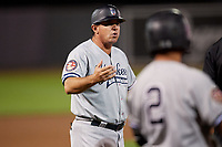 Staten Island Yankees manager Lino Diaz (30) argues with home plate umpire Tyler Witte (not pictured) as second baseman Jesus Bastidas (2) looks on during a game against the Aberdeen IronBirds on August 23, 2018 at Leidos Field at Ripken Stadium in Aberdeen, Maryland.  Aberdeen defeated Staten Island 6-2.  (Mike Janes/Four Seam Images)