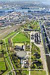 Nederland, Noord-Holland, Amsterdam, 09-04-2014;<br /> Cultuurpark Westergasfabriek en Westerpark op het voormalige  Westergasterrein langs Haarlemmerweg, rechtsbeneden van het kanaal woonwijk de multiculturele Staatsliedenbuurt. <br /> Spoor met treinen boven in beeld. Spaarndammerbuurt met Houthavens, Westelijke Eilanden en Westerdok , IJ  en Amsterdam-Noord.<br /> Buildings of Culture park Westergasfabriek and the Westerpark on the former Westergasterrein (gasworks) along the railroad from Amsterdam Central station. View on the North of Amsterdam.<br /> luchtfoto (toeslag op standard tarieven);<br /> aerial photo (additional fee required);<br /> copyright foto/photo Siebe Swart