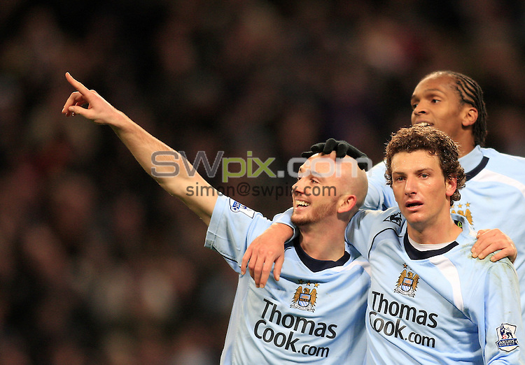 Pix: Chris Mangnall/SWpix.com, Football   Barclays Premier League. 26/12/08 Manchester City v Hull City....picture copyright>>Simon Wilkinson>>07811267 706>>....Man City's 5th Goal scorer Stephen Irland (l) congratulated by Elano and Jo