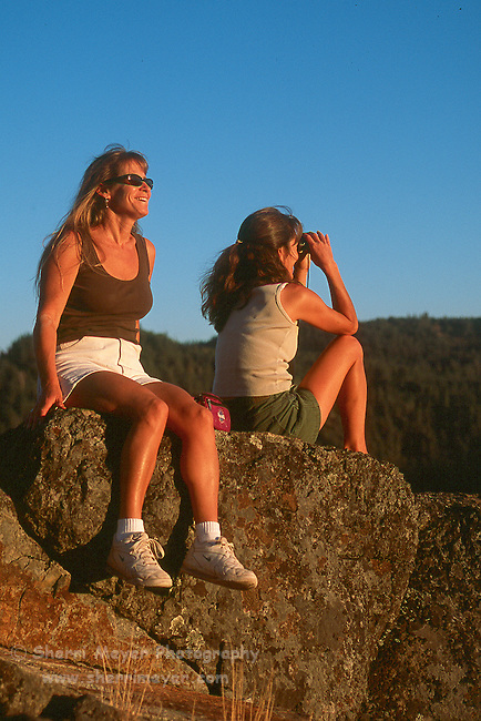 Two women enjoying the American River Canyon at sunset