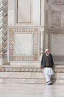 Agra, India.  Taj Mahal. Indian Man Wearing Shoe Covers to Protect Taj Tiles from Scratching.