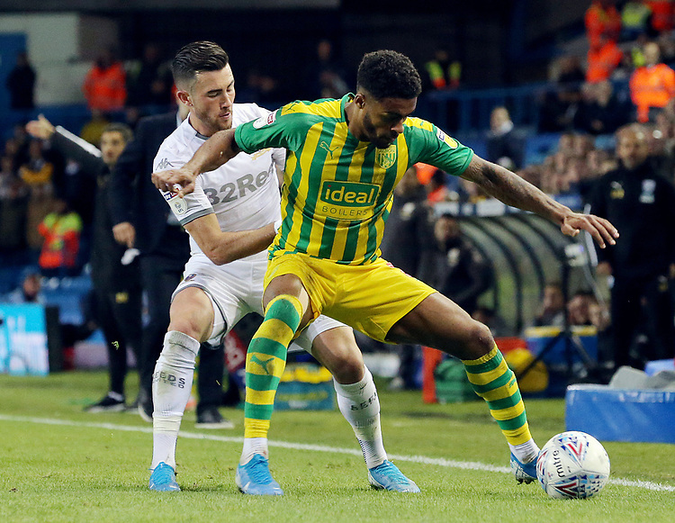 West Bromwich Albion's Darnell Furlong shields the ball from Leeds United's Jack Harrison<br /> <br /> Photographer Rich Linley/CameraSport<br /> <br /> The EFL Sky Bet Championship - Tuesday 1st October 2019  - Leeds United v West Bromwich Albion - Elland Road - Leeds<br /> <br /> World Copyright © 2019 CameraSport. All rights reserved. 43 Linden Ave. Countesthorpe. Leicester. England. LE8 5PG - Tel: +44 (0) 116 277 4147 - admin@camerasport.com - www.camerasport.com