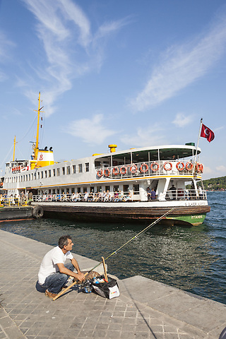 Man fishing on quayside, and passenger ferry in Karakoy Cruise Terminal, Bosphorus Strait, Istanbul, Turkey  May 2015.<br /> CAP/MEL<br /> &copy;MEL/Capital Pictures /MediaPunch ***NORTH AND SOUTH AMERICA ONLY***
