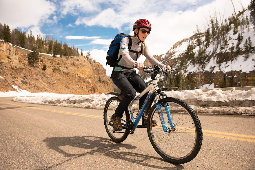 Christine Marozick of Bozeman, Montana rides toward Swan Lake Flat in Yellowstone National Park.