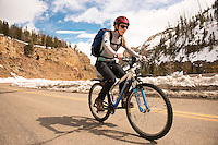 Christine Marozick of Bozeman, Montana rides toward Swan Lake Flat in Yellowstone National Park.