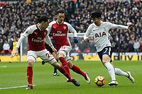 Son Heung-Min of Tottenham Hotspur and Hector BellerÌn of Arsenal during Tottenham Hotspur vs Arsenal, Premier League Football at Wembley Stadium on 10th February 2018