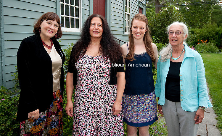 WOODBURY,  CT--- -070916JS06-Adrienne Artale, volunteer shop keeper, Director LoriAnn Witte, volunteer Catrina Meyer and board member Pricilla Price at the Glebe House Museum's Wine &amp; Roses  garden party held at Glebe House in Woodbury. Proceeds from the event will go to support the renovation and preservation of the Gertrude Jekyll Garden. <br /> Jim Shannon Republican American