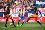 Kevin Gameiro of Atletico de Madrid (center) competes for the ball with Eliaquim Hans Mangala of Valencia CF (left) and Ezequiel Garay of Valencia CF (right) during the match Atletico de Madrid vs Valencia CF, a La Liga match at the Estadio Vicente Calderon on 05 March 2017 in Madrid, Spain. Photo by Diego Gonzalez Souto / Power Sport Images