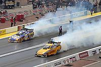 Apr. 7, 2013; Las Vegas, NV, USA: NHRA funny car driver Del Worsham (near lane) burns out alongside Ron Capps during the Summitracing.com Nationals at the Strip at Las Vegas Motor Speedway. Mandatory Credit: Mark J. Rebilas-