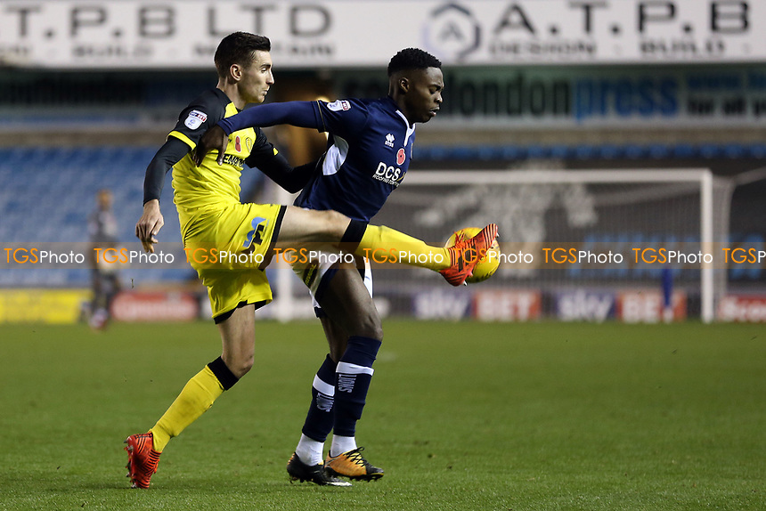 Fred Onyedinma of Millwall and Stephen Warnock of Burton Albion during Millwall vs Burton Albion, Sky Bet EFL Championship Football at The Den on 4th November 2017