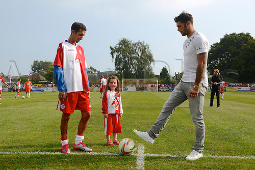 07.09.2014.  Poole, England. Charity match in aid of MND sufferer Andrew Culliford. Andrew Culliford and his daughter Isla kick off the match with former Poole Town teammate, QPR striker Charlie Austin.