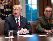 United States President Donald J. Trump makes a statement to the media as he prepares to receive a briefing from senior military leaders in the Cabinet Room of the White House in Washington, DC on Tuesday, October 23, 2018.  The President took questions on the proposed space force, immigration, the caravan and Saudi actions in the killing of Jamal Khashoggi.  Looking on from the right is US Marine Corps General Joseph F. Dunford, Chairman of the Joint Chiefs of Staff.<br /> Credit: Ron Sachs / Pool via CNP