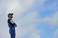 Jimmie Johnson (#48) watches practice from atop his hauler.