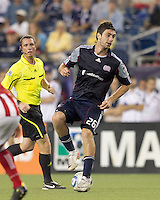 New England Revolution midfielder Stephen McCarthy (26) dribbles. In a Major League Soccer (MLS) match, Chivas USA defeated the New England Revolution, 3-2, at Gillette Stadium on August 6, 2011.