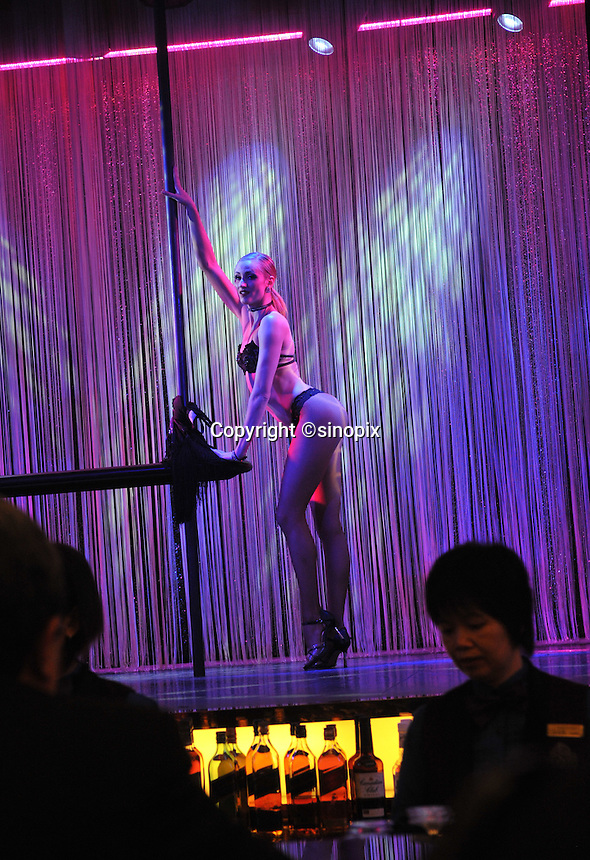 "Dancers perform at a bar in the New Lisboa Casino in Macau, 25th October 2008.  Macau is known simply as ""Vegas"" in China. The former Potuguese colony, now a Chinese Special Administrative Region, attracts millions of Chinese gamblers annually and last year earned more gambling dollars than Las Vegas."