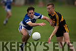 Jack Savage of Kerins O'Rahillys and Fionn Fitzgerald  of Dr Crokes keenly contest for the ball, in the last round game of the Senior Club Championship in Strand Road on Saturday evening.
