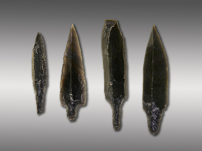 Black obsidian arrow heads. Catalhoyuk Collections. Museum of Anatolian Civilisations, Ankara. Against a grey background