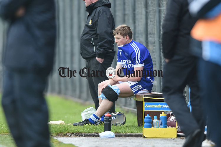 An injured Podge Collins of Cratloe sits  at the dug out  during their match against Ballyea in Ennis. Photograph by John Kelly.