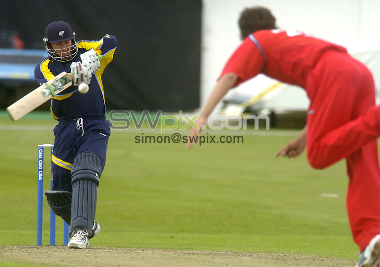 Picture by Chris Whiteoak/SWPIX.COM, C and G Trophy, Yorkshire v Lancashire, 28/05/06..Copyright>>Simon Wilkinson>>07811267706..Yorkshire's Craig White scores a 4 off Lancashire's Kyle Hogg