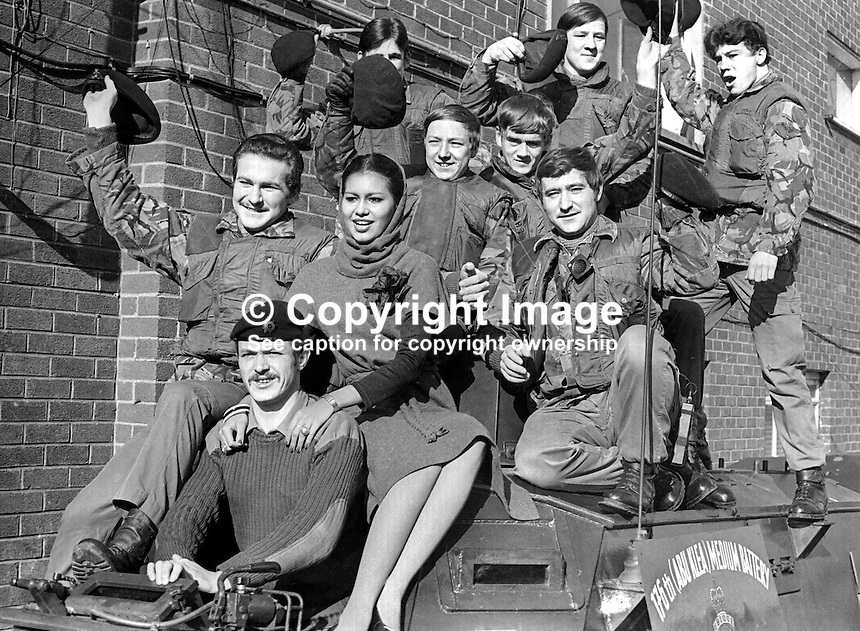 Miss World 1975, Wilnelia Merced, on a visit to British troops serving in N Ireland, poses on an armoured personnel carrier with members of the Royal Artillery Regiment, 176th (ABU KIEA) Medium Battery. Miss Merced, from Puerto Rico, married entertainer and television personality Bruce Forsythe in 1983. 197603260183a<br /> <br /> Copyright Image from Victor Patterson, 54 Dorchester Park, Belfast, UK, BT9 6RJ<br /> <br /> Tel: +44 28 9066 1296<br /> Mob: +44 7802 353836<br /> Voicemail +44 20 8816 7153<br /> Skype: victorpattersonbelfast<br /> Email: victor@victorpatterson.com<br /> Email: victorpatterson@me.com (back-up)<br /> <br /> IMPORTANT: If you wish to use this image or any other of my images please go to www.victorpatterson.com and click on the Terms & Conditions. Then contact me by email or phone with the reference number(s) of the image(s) concerned.