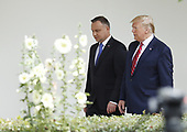 US President Donald J. Trump and Polish President Andrzej Duda (L) walk along the Colonnade at the White House in Washington, DC, USA, 12 June 2019. During the visit President Trump and President Duda will participate in a signing ceremony to increase military to military cooperation including the purchase of F-35 fighter jets and an increased US troop presence in Poland. <br /> Credit: Shawn Thew / Pool via CNP