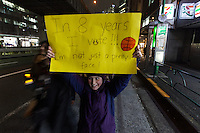 A young girl at a protest march by members of the Democratic Party Abroad organisation to mark the inauguration of President Donald Trump, Tokyo, Japan. Friday January 20th 2017 Around 400 people took apart in the march, which started in Hibiya Park at 6:30pm and finished in Roppongi just before 8pm, to honour the service given by President Obama and to protest against the illiberal policies expected of the new administration of President  Trump.