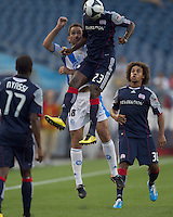 New England Revolution midfielder Joseph Niouky (23) beats Puebla FC defender Juan Garcia (18) to a thrown in ball. The New England Revolution defeated Puebla FC in penalty kicks, in SuperLiga 2010 semifinal at Gillette Stadium on August 4, 2010.