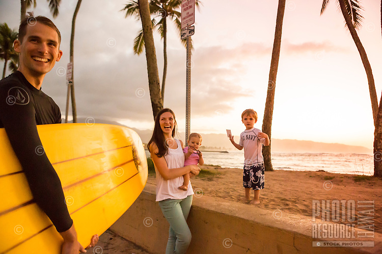 A happy family of four at Hale'iwa Beach Park, North Shore, O'ahu.