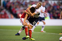 George Saville of Millwall wrestles Zach Clough of Nottingham Forest to the ground during the Sky Bet Championship match between Nottingham Forest and Millwall at the City Ground, Nottingham, England on 4 August 2017. Photo by James Williamson / PRiME Media Images.