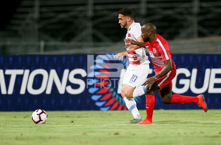 GEORGETOWN, GRAND CAYMAN, CAYMAN ISLANDS - NOVEMBER 19: Cristian Roldan #10 of the United States and Jose Almelo #18 battle for a ball during a game between Cuba and USMNT at Truman Bodden Sports Complex on November 19, 2019 in Georgetown, Grand Cayman.