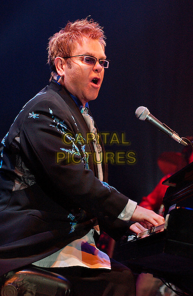 "SIR ELTON JOHN.performs as a part of his ""The Captain & The Kid Tour""  held at the Mellon Arena.  Pittsburgh, Pennsylvania, USA,.06 October 2006..concert music gig on stage live half length playing piano mouth open funny.Ref: ADM/JN.www.capitalpictures.com.sales@capitalpictures.com.©Jason L Nelson/AdMedia/Capital Pictures."