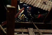 Port Au Prince, Haiti, Jan 23 2010.Wisman Gentil, 23, was pulled out from a collapsed building by a French Rescue team (Protection Civile & Sapeurs Pompiers) 11 days after the tragedy. The French Ambassador is on the scene, being kept informed by the 2 colonels in charge of the operation..