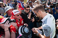 March 13, 2014: Jenson Button (GBR) from the McLaren Mercedes team signs autographs at the 2014 Australian Formula One Grand Prix at Albert Park, Melbourne, Australia. Photo Sydney Low.