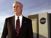 The new National Aeronautics and Space Administration (NASA) Administrator,  Sean O'Keefe,  poses for a photo with the Vehicle Assembly Building in the background at the Kennedy Space Center (KSC), Florida on February 15, 2002  . Space Shuttle Columbia is poised on the pad behind him for launch February 28, 2002 and mission STS-109. The administrator was at KSC on an agencywide familiarization tour of NASA field centers. He was nominated for the position as administrator in November,  2001 by United States President George W. Bush. He was sworn in December 21, 2001 as the agency's 10th chief.  O'Keefe resigned his position on December 13, 2004.<br /> Mandatory Credit: Michael R. Brown / NASA via CNP