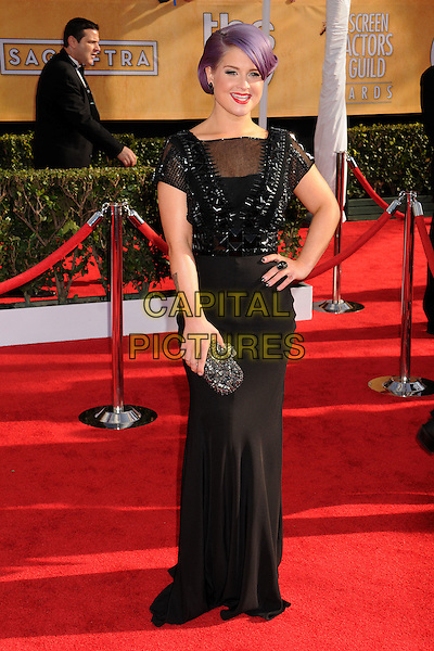 Kelly Osbourne.Arrivals at the 19th Annual Screen Actors Guild Awards at the Shrine Auditorium in Los Angeles, California, USA..27th January 2013.SAG SAGs full length black dress beads beaded hand on hip purple hair dyed clutch bag.CAP/ADM/BP.©Byron Purvis/AdMedia/Capital Pictures
