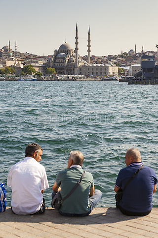 Three men on quayside and the New Mosque, Eminonu Yeni Camii, Eminonu, Istanbul, Turkey  May 2015.<br /> CAP/MEL<br /> &copy;MEL/Capital Pictures /MediaPunch ***NORTH AND SOUTH AMERICA ONLY***