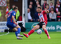 Lincoln City's Neal Eardley vies for possession with Sunderland's Lynden Gooch<br /> <br /> Photographer Andrew Vaughan/CameraSport<br /> <br /> The EFL Sky Bet League One - Lincoln City v Sunderland - Saturday 5th October 2019 - Sincil Bank - Lincoln<br /> <br /> World Copyright © 2019 CameraSport. All rights reserved. 43 Linden Ave. Countesthorpe. Leicester. England. LE8 5PG - Tel: +44 (0) 116 277 4147 - admin@camerasport.com - www.camerasport.com