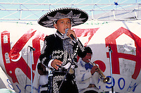 HISPANIC MARIACHI VOCALIST (BOY) SINGING AT CULTURAL FESTIVAL. YOUNG MARIACHI VOCALIST. SAN JOSE CALIFORNIA.