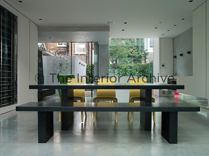 The intention throughout was to create a seamless, cohesive living space united by the clean lines and concrete floors. The minimal dining table and bench were sourced by Rodic Davidson and the yellow chairs are from B&B Italia