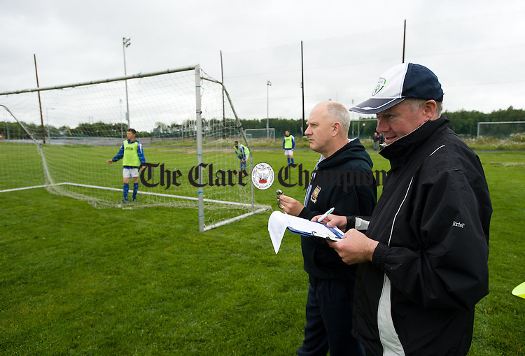 Tommy Molloy, schoolboys soccer chairman and Martin Hehir,r joint team manager counting hits and timing the event during the Clare Kennedy Cup squad's world record attempt at hitting the crossbar as many times as possible in one hour. Photograph by John Kelly.