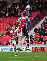 Doncaster Rovers' Mathieu Baudry gives away a penalty, for handball, under pressure from Blackpool's Jamille Matt<br /> <br /> Photographer Chris Vaughan/CameraSport<br /> <br /> The EFL Sky Bet League Two - Doncaster Rovers v Blackpool - Keepmoat Stadium - Doncaster<br /> <br /> World Copyright &copy; 2017 CameraSport. All rights reserved. 43 Linden Ave. Countesthorpe. Leicester. England. LE8 5PG - Tel: +44 (0) 116 277 4147 - admin@camerasport.com - www.camerasport.com