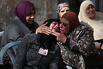 Relatives of Palestinian Abdullah Tawalba, 19, mourn during his funeral in the West Bank village of Jalama, south of Jenin, on February 5, 2019. Tawalba was shot dead and another wounded the previous day in a clash at a military checkpoint in the northern West Bank, Palestinian officials said, without giving further details. Photo by Shadi Jarar'ah