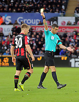 Matt Ritchie of Bournemouth is shown a yellow card by match referee Andrew Marriner for his foul against Andre Ayew of Swansea during the Barclays Premier League match between Swansea City and Bournemouth at the Liberty Stadium, Swansea on November 21 2015